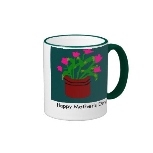 Flores rosadas en el florero para la taza del día