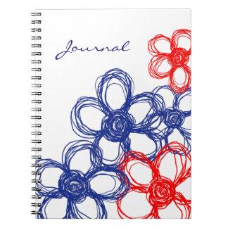 Flores salvajes azules y rojas cuaderno