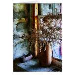 Flores secadas en Windowsill Felicitación