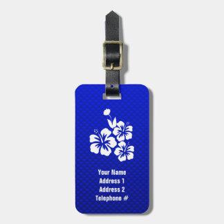 Flores tropicales azules etiquetas maletas