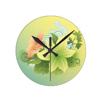 Flores tropicales reloj redondo mediano