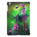 Flores y abeja rosadas contra el iPad del mundo