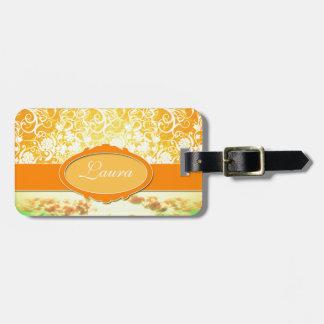 Flores y cielo femeninos anaranjados conocidos de  etiquetas maletas