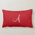 Flores y círculos retros rojos del monograma almohadas
