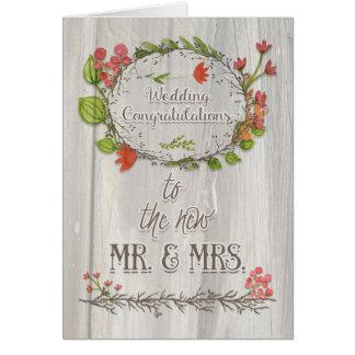 Flores y guirnalda rústicas de la enhorabuena del tarjeta de felicitación