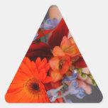 Flores y Hans Pegatina Triangular