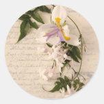 flores y lirio del jazmín con el pegatina redondo