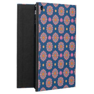 Flores y lunares de Rangoli en la caja azul del