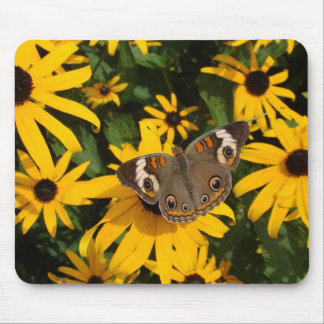 Flores y mariposa amarillas tapete de ratones