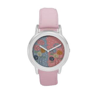 flores y mariposas reloj
