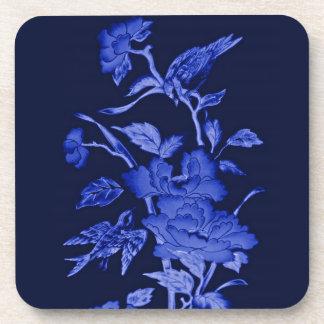Flores y pájaros, diseño gráfico en azules posavasos