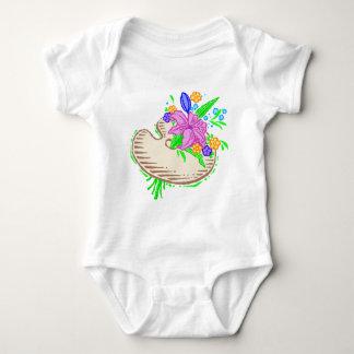 Flores y paleta del artista body para bebé
