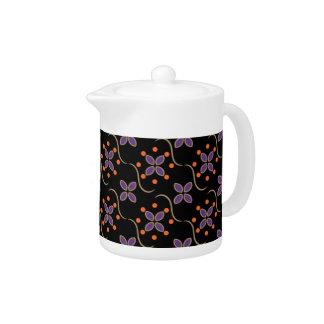 Flores y puntos púrpuras y anaranjados