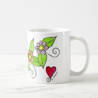 Flores y un corazón taza