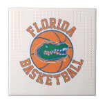 """Florida Basketball   Gator Head Ceramic Tile<br><div class=""""desc"""">Check out this custom Florida Basketball icon with the Gator Head icon. Zazzle offers the most exciting and unique gear for the ultimate Florida Gator fan! All of our products are officially licensed and customizable, which makes them perfect for students, alumni, family, fans, and faculty. Whether you are gearing up...</div>"""