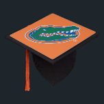 """Florida Gator Head Graduation Cap Topper<br><div class=""""desc"""">Zazzle offers the most exciting and unique gear for the ultimate Florida Gator fan! All of our products are officially licensed and customizable, which makes them perfect for students, alumni, family, fans, and faculty. Whether you are gearing up for tailgating, hosting a party for a Florida fan, or decorating your...</div>"""