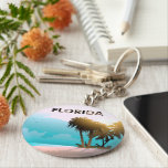 "Florida Keychain<br><div class=""desc"">Fond of Florida&#39;s sandy beaches and clear water? This cool Sunshine State souvenir will surely make you think of them!</div>"