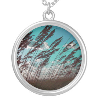 Florida seaoats against teal sky dune backdrop round pendant necklace