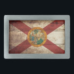 """Florida State Flag on Old Wood Grain Rectangular Belt Buckle<br><div class=""""desc"""">Florida State Flag on Old Wood Grain Feel free to modify the design according to your own preferences. You may change the design location, orientation, background colors and size. Also, you may add your own text, or slogan set its font, location and size, all in order to create the ultimate...</div>"""
