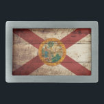 "Florida State Flag on Old Wood Grain Rectangular Belt Buckle<br><div class=""desc"">Florida State Flag on Old Wood Grain Feel free to modify the design according to your own preferences. You may change the design location, orientation, background colors and size. Also, you may add your own text, or slogan set its font, location and size, all in order to create the ultimate...</div>"