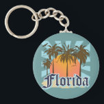 "Florida The Sunshine State USA Keychain<br><div class=""desc"">Florida tropical beach vacation tourism souvenir t-shirts and gifts. Mementos for your trip to the beautiful state of Florida, or gear the the proud native Floridians! Cool retro vintage style Florida graphic design logo. Visit Florida. Orlando, Miami, Destin, Fort Myers, Fort Lauderdale, St Augustine, Clearwater Beach, Cocoa Beach, Panama City...</div>"