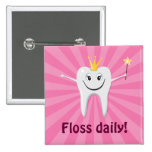 Floss daily tooth fairy on a pink sunburst pinback buttons