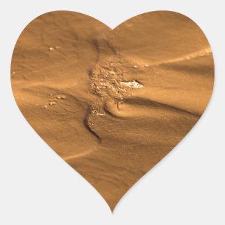 Flow structures in wet mud heart sticker