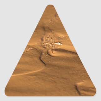 Flow structures in wet mud triangle sticker