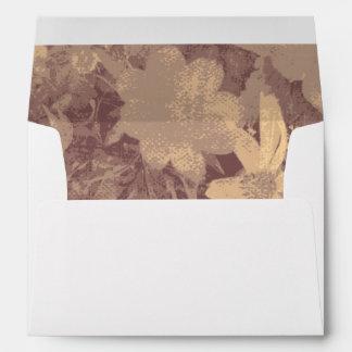 Flower and leaf camouflage pattern on beige envelope