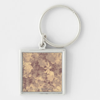 Flower and leaf camouflage pattern on beige keychain