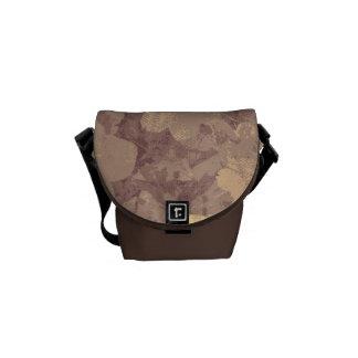 Flower and leaf camouflage pattern on beige messenger bag