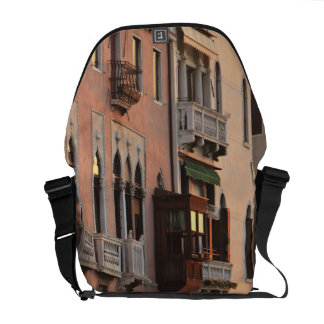 flower baskets and ornate Palace details, Italy Messenger Bags