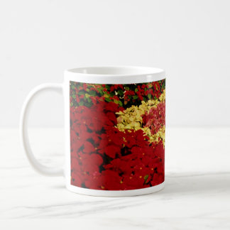 Flower bed, red, white and pink poinsettias mugs