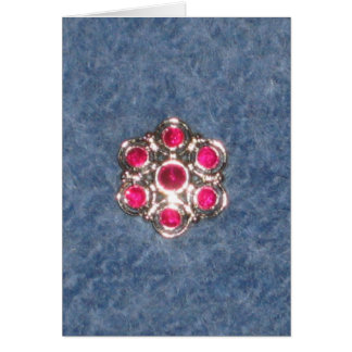 Flower button on blue felted background greeting cards