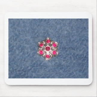 Flower button on blue felted background mousepads