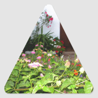 Flower filled  garden in Chania Crete, Greece Triangle Sticker