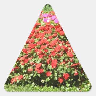 Flower Garden of Pink & Red Flowers Next to Grass Triangle Sticker