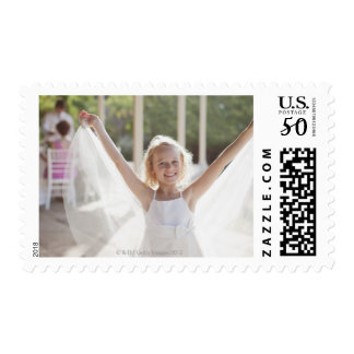 Flower girl with arms outstretched postage