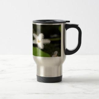 Flower of a floatingheart travel mug