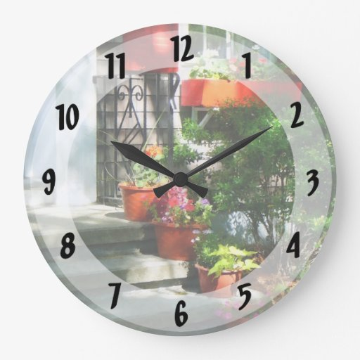 Flower Pots and Red Shutters Round Wall Clock