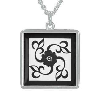 Flower with vines growing off square pendant necklace