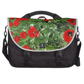 Flowerbed with red tulips computer bag