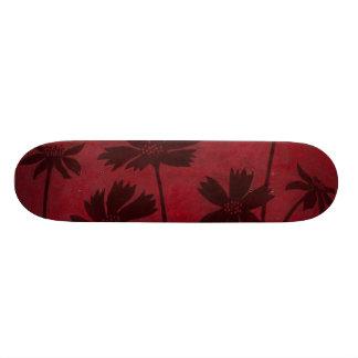 Flowerhead Silhouettes on Crimson Background Skateboard Deck
