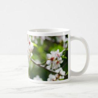 Flowering branches of fruit tree coffee mug