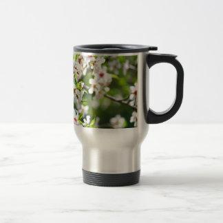 Flowering branches of fruit tree travel mug