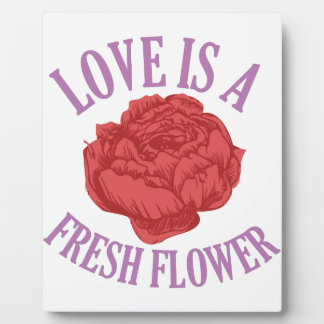 Flowers add unique style and cheer to any space. plaque