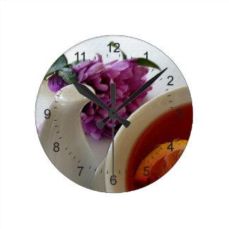 flowers and tea round clock