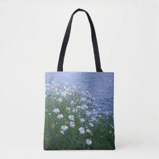 Flowers by the ocean tote bag