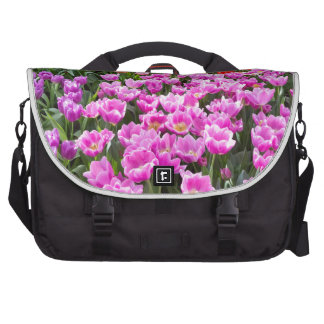 Flowers field with different colored tulips commuter bags