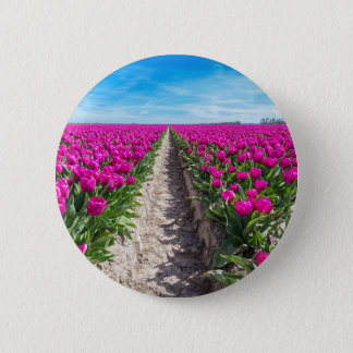 Flowers field with purple tulips and path pinback button